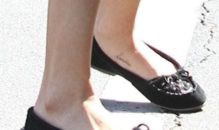 selena gomez cross tattoo selena gomez may be sporting a secret on foot