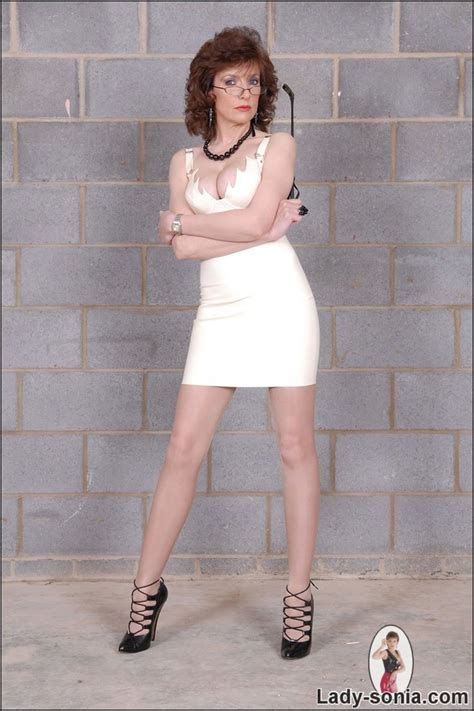 lady sonia in tiny dress flirtatious mom lady sonia poses in sheer pantyhose and
