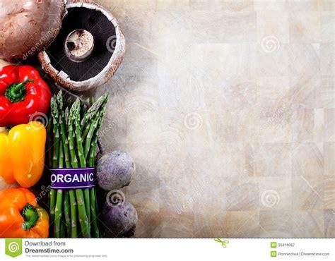 Kitchen Design Program organic vegetables on cutting board background royalty