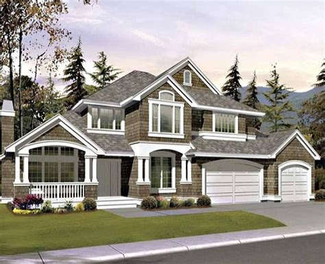 Two Story Custom Home With Exterior Shake Detailing Has House Plans With Arched Porch