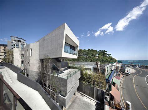 house architect architect k establishes monolithic house along the coast