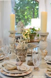 Beach table setting nautical tablescape with shell chargers and shell