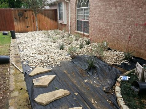 river rock flower bed flower mound river rock bed southwestern exterior