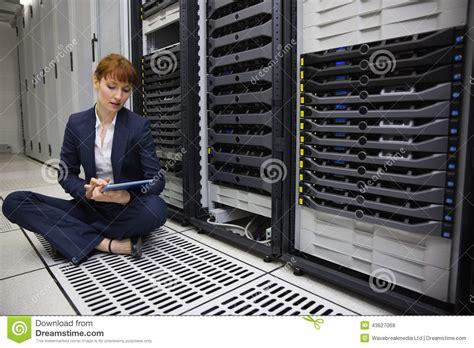 Floor Technician by Technician Sitting On Floor Beside Server Tower Using