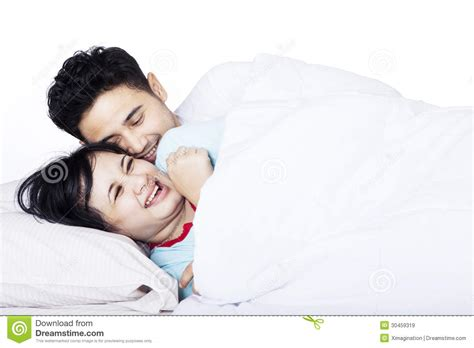 romantic couple in bed images romantic asian couple in bed isolated royalty free stock