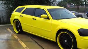 yellow dodge magnum on 24 quot staggered asantis