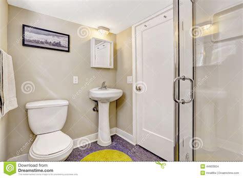 Simple Bathroom Interior With Purple Floor And Light Beige