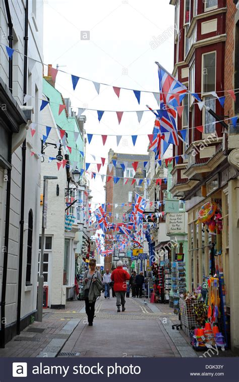 weymouth shop narrow shopping with union bunting and gift shops stock photo royalty