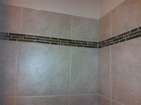 Shower Over Bath Designs shower accent tile with metal edging bathroom seattle