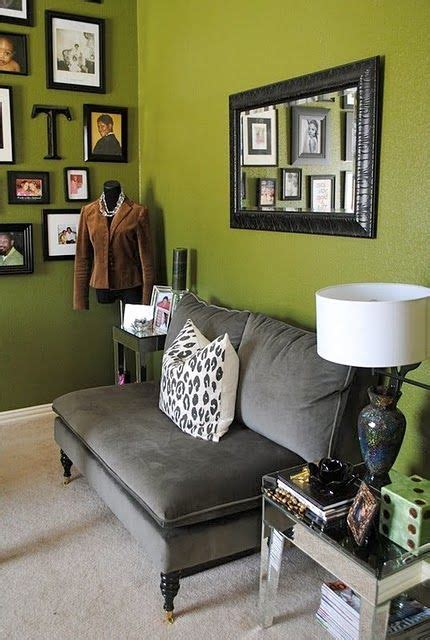 grey couch olive green walls  wall  frames
