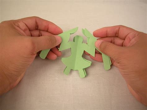 How Do You Make A Paper Doll Chain - how to make a circle of paper chain 6 steps