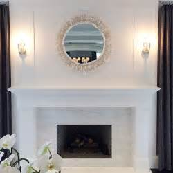 white marble fireplace surround with a gray herringbone