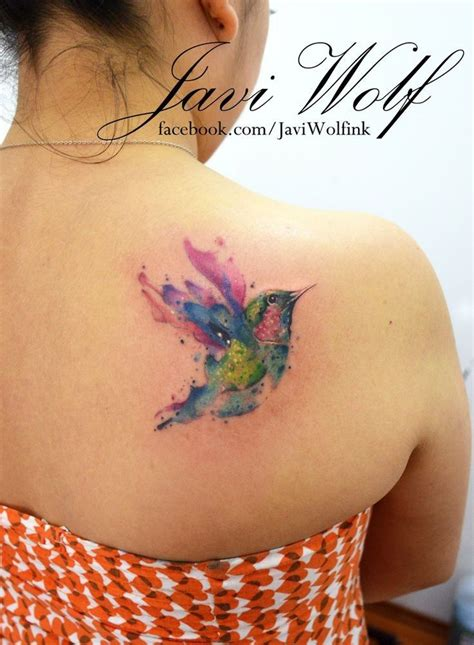 watercolor tattoo upper back flying bird watercolor on back