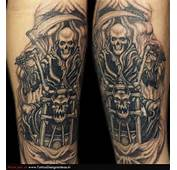 Grey Ink Grim Reaper Skull Tattoo On Sleeve