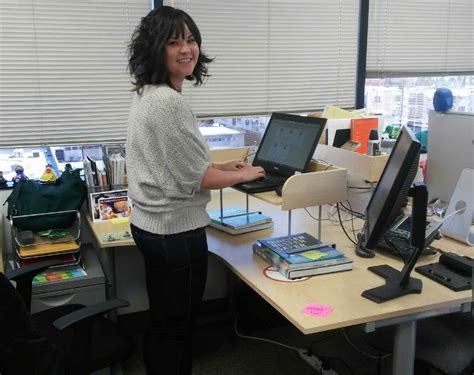 The Office Standing Desk Office Hack Why I Switched To A Standing Desk