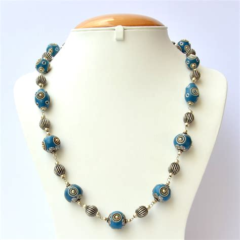 Handmade Necklace - blue handmade necklace studded with metal rings metal