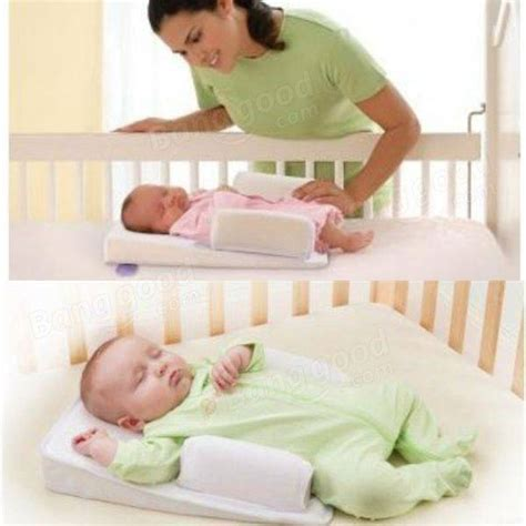 how to stop baby rolling around in cot baby sleep positioner pillow anti roll sleeping mat safe