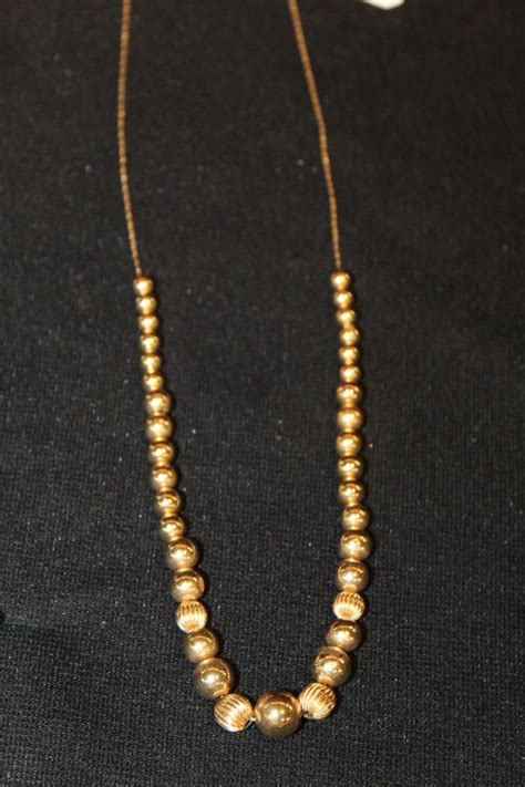 add a bead 14kt yellow gold add a bead