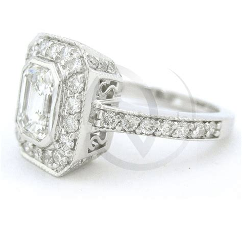 emerald cut antique style bezel set engagement