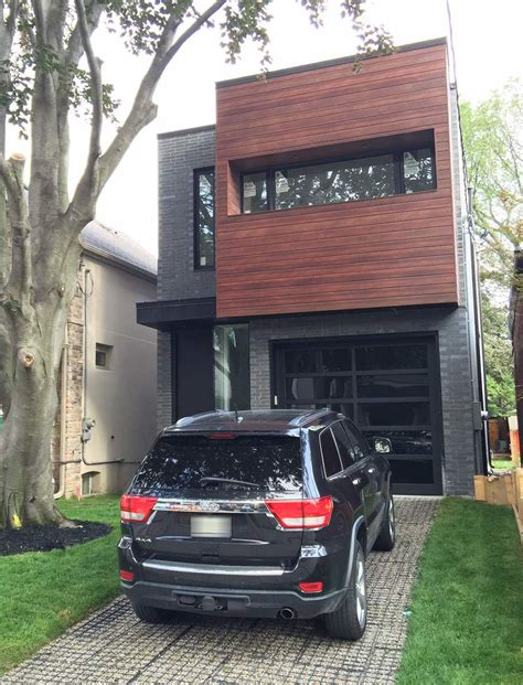 longboard siding installed with brick installed by