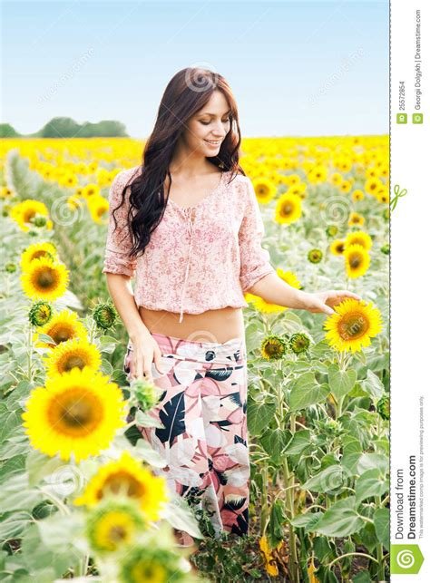 beautiful lady beautiful lady in sunflower field stock images image