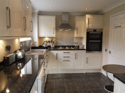 cream and black kitchen ideas cream kitchen black floor wooden worktop google search