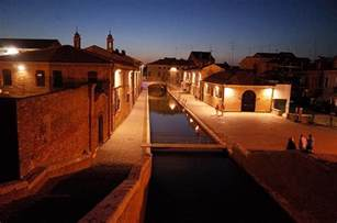 The canals and stunning architecture of Comacchio at night, northern Italy's 'Little Venice
