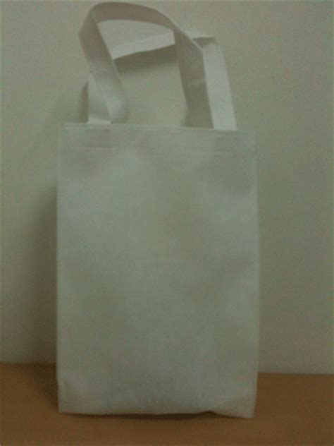 tas spunbond goodiebag polos ready stock perdana goodie bag