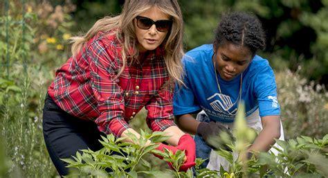 melania trump embraces michelle obamas vegetable garden