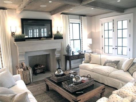 living room furniture arrangement with tv fireplaces window and coffee on