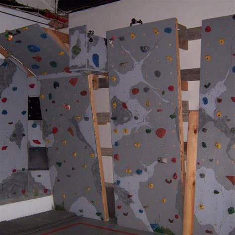 home made rock climbing wall wall with black and grey
