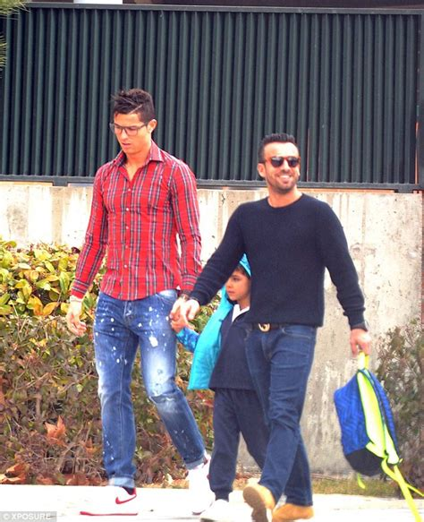 Cristiano ronaldo dons geeky glasses to pick up his son from school after landing a two match
