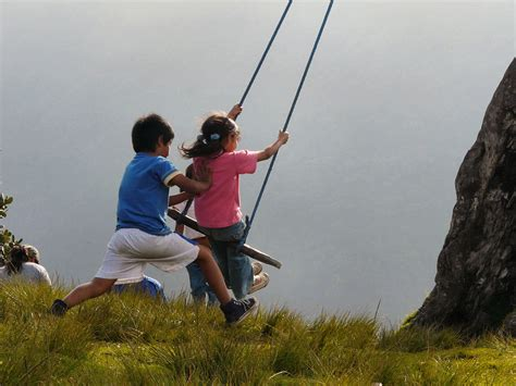swing ecuador riding a swing over a cliff in ecuador is bucket list
