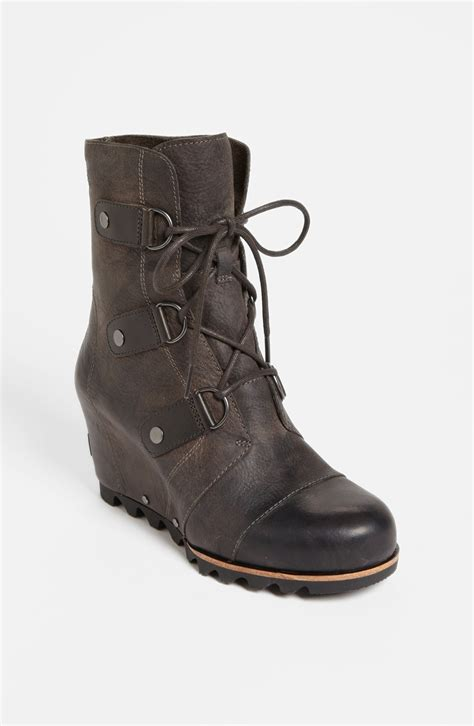 sorel boots sorel joan of arctic wedge boot in black black grill lyst