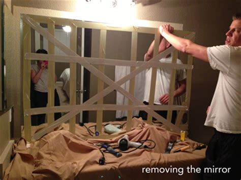 how to remove wall mirror in bathroom moving along that was easy let s do it again 2