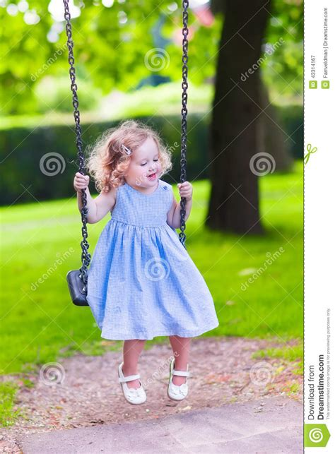 little girl on swing little girl on a swing stock photo image 43314167