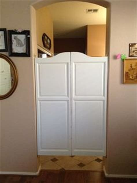 how do you a door into a swinging bookcase 1000 ideas about swinging doors on swinging