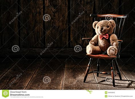 Antique Windsor Armchair Vintage Teddy Bear Stuffed Animal Toy On Old Chair Stock