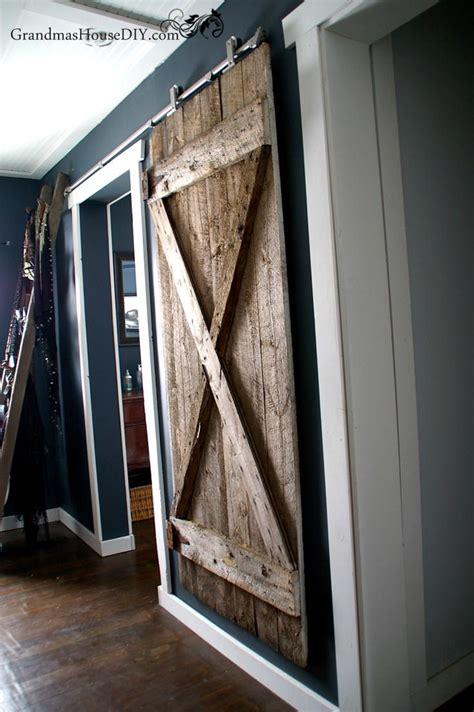 hanging a barn door rustic hanging diy barn door diyideacenter