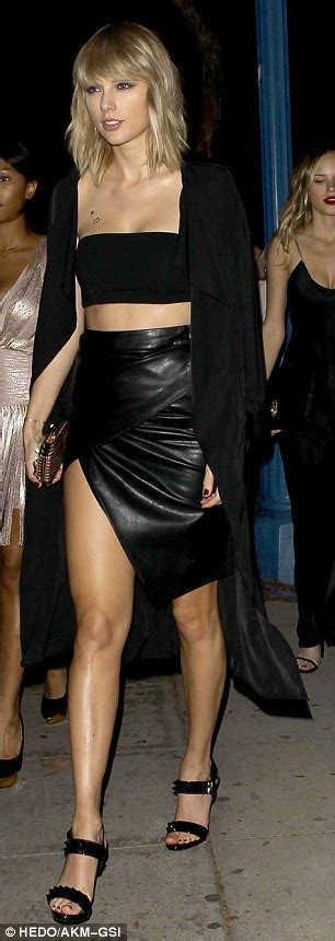 taylor swift wears racy split skirt and bandeau bra to