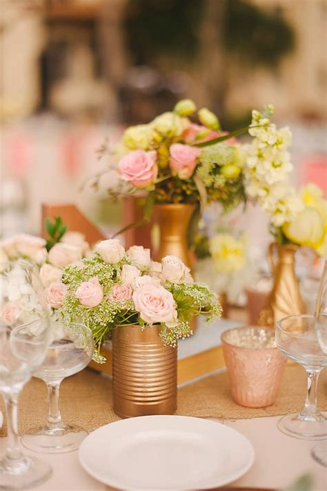 easy centerpiece idea spray paint cans gold and fill with