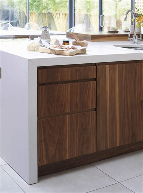 modern walnut kitchen cabinets corian countertops pros and cons decoholic