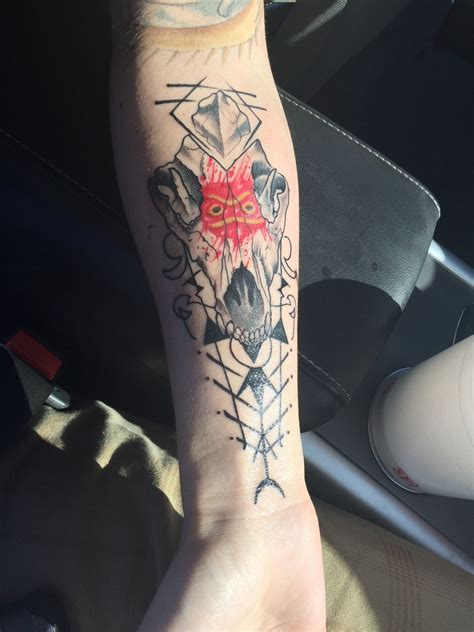 atomic tattoos wolf skull with san s mask from princess mononoke done by