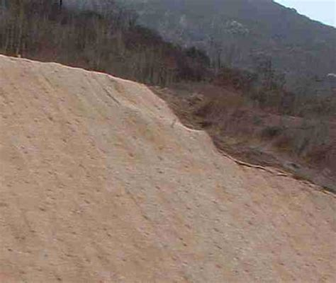 how to landscape a hillside slope to stabilize and - Straw Landscape Matting