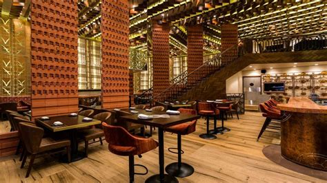Cafe Interiors Liquifloor Makes Walking by Dining Mumbai S Farzi Cafe Serves Up Scrumptious Indian