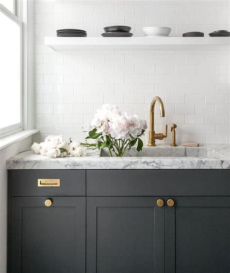 marble knobs for cabinets dark gray kitchen cabinets accented with aged brass knobs