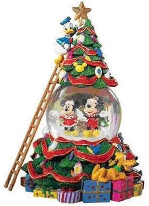 ultimate disney character tree disney tree snowglobe by radko snow globes disney trees and