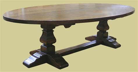 large oval oak pedestal dining table with square cut legs
