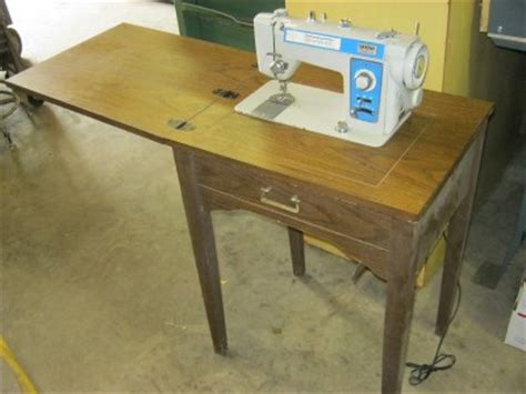 sewing machine mounted in hide away table ebay