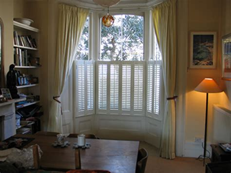 shutters with curtains changing curtains